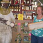 Wes and Sue showcase the honey produced on the farm.